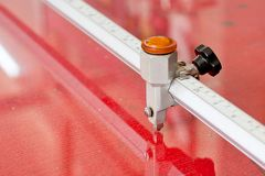 Glass cutting on red working table royalty free stock images