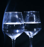 Glass in the dark. Glass with water in the dark (background Stock Photo