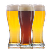 Glass of Dark Ale and Two Pale Ales Royalty Free Stock Image