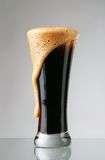 Glass of dark beer Royalty Free Stock Image