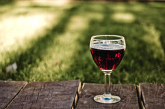 Glass of dark beer. A glass of dark beer standing on the wooden table Stock Photos