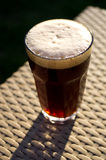 Glass of dark beer Stock Photos