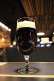 Glass of dark beer on the bar closeup Stock Photo