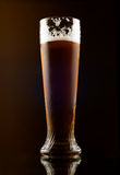 Glass of dark beer on a black Stock Photo