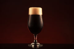 Glass of dark beer Royalty Free Stock Photos