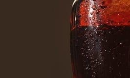 Glass of dark beer (fragment) Stock Images