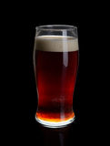 A glass of dark beer. Royalty Free Stock Photography