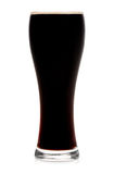 Glass of dark beer isolated Royalty Free Stock Image