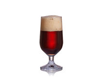 Glass of dark beer isolated on white background Stock Images