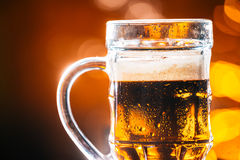 Glass dark beer mug on a blurred background Stock Photography