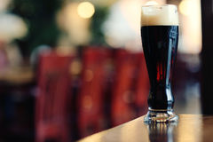 Glass of dark beer Stock Images