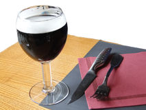 Glass of dark beer on restaurant table Royalty Free Stock Photography