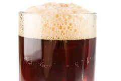 Glass dark beer with rich froth Royalty Free Stock Photography