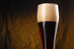 Glass of dark beer Stock Photo