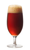 Glass of dark beer. On white background stock image