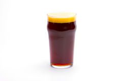 Glass of dark beer. On a white background stock photography