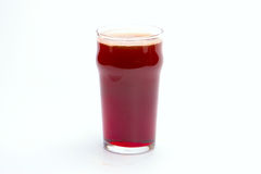 Glass of dark beer. On white background royalty free stock photography