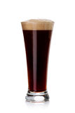 Glass of dark beer on white Royalty Free Stock Photography