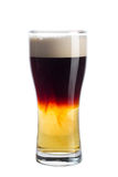 Glass of dark beer on white background Royalty Free Stock Image