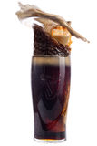 Glass of dark beer on a white background, splash Royalty Free Stock Photography