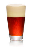 Glass of dark beer on white Stock Photo