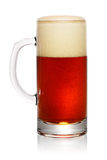 Glass of dark beer on white Royalty Free Stock Image
