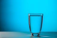 Glass on dark blue background Stock Photo