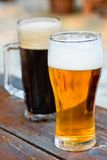 Glass dark and light of beer Stock Photos