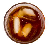 Glass with dark liquid full with ice cubes. Glass with ice tea full with ice cubes on white background Stock Photography