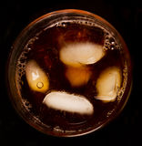 Glass with dark liquid full with ice cubes Stock Image