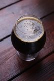 Glass of dark stout Royalty Free Stock Images