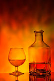 Glass and decanter of cognac Royalty Free Stock Photography