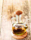 Glass decanter with olive oil Royalty Free Stock Photography