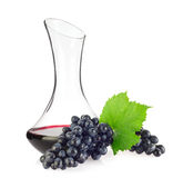 Glass decanter with red organic wine and blue grapes Royalty Free Stock Photos