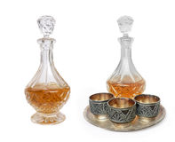 Glass decanter and three vintage Melchior cups. Glass decanter with wine and three vintage Melchior cups Royalty Free Stock Photos