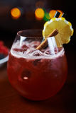Glass of delicious alcoholic cocktails or lemonade with ice, decoration of fresh berries and a slice of lemon on a wooden table in Royalty Free Stock Photo