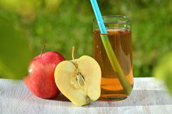 Glass of delicious apple juice and apple on table Royalty Free Stock Photo
