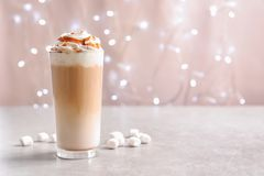 Glass with delicious caramel frappe. On table Stock Photo