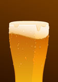 Glass of delicious fresh cold beer on brown background Stock Photos