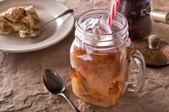Iced Coffee. A glass of delicious iced coffee with tiramisu stock photography