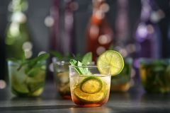 Glass with delicious mint julep cocktail. On bar counter stock image