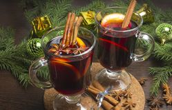 Glass of delicious mulled wine on table, closeup stock photo