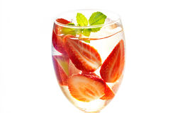 Glass delicious refreshing drink of strawberry with mint on white background Stock Images
