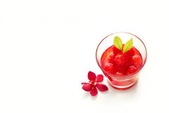 Glass delicious refreshing drink of vibrant watermelon on white background Stock Images