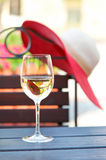 Glass of delicious white wine in summer restaurant. Outdoors. Stock Photos