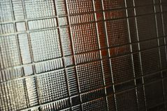 Glass dented background in the form of square wafers, squares and direct reliefs. Excellent variants of construction, industrial backgrounds for your work and royalty free stock images