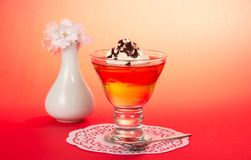 Glass with dessert, teaspoon and napkin Stock Photo
