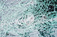 Glass destroyed in thousands of cracks and tears. Glass destroyed in thousands of cracks like a dense web of cuts Royalty Free Stock Photo
