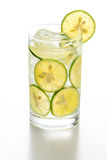 Glass of Detox water with Sudachi. Flavor water with Sudachi in glass Stock Photography