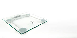 Glass Digital Weighing Machine. On white back ground stock photography